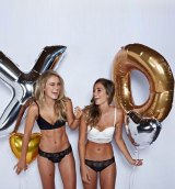 Stephanie Smith posts a photo of herself at a photo shoot for Exs and Ohs lingerie