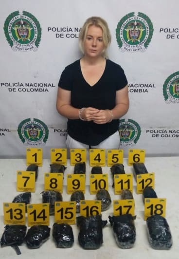 Colombian police released this photo of Cassandra Sainsbury with the drugs she is said to have smuggled.