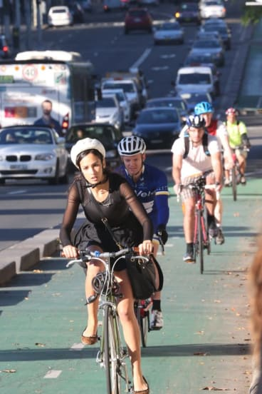 Safer passage: Cyclists ride along the bike lane on College Street.