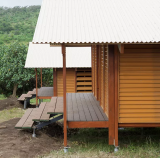 Kelly Wright plans to train the Jilkminggan community to build Nev Homes, like these, to help them out of 'third-world conditions'.