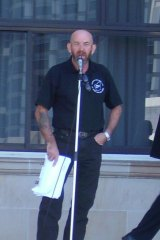 Motorcycle Riders Association of WA president Dave Wright speaks at a rally at Parliament House.