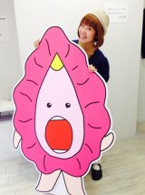 Megumi Igarashi with one of her drawings.