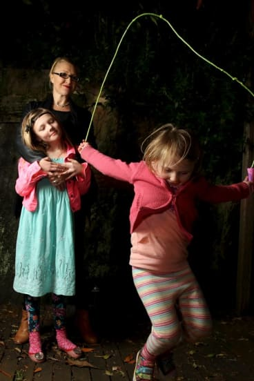 Higher fees but fewer vacancies for after-school care: Jo Karabin with daughters Mila and Kiki (right).