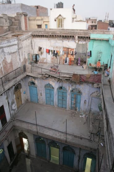 People squatting in the old haveli prior to restoration.