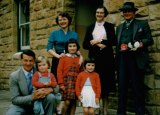 All together then: Julie Bishop as a child in the late 1950s, being held by her father, Douglas. Her mother has her hands on sister MaryLou, while sister Patricia stands in front of her grandparents Hilda and William.