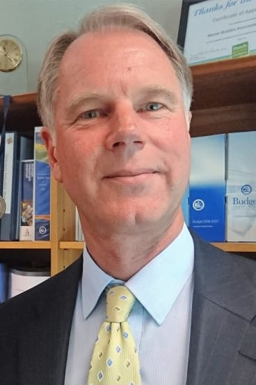"""Work Safety Commissioner Greg Jones: Ainslie shops asbestos building: Once cleaned, the building might be allowed to stand """"for quite a number of years""""."""