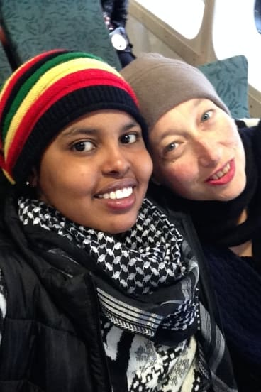 Hani Abdile with Janet Galbraith on the ferry to Manly in 2015, after Hani was moved to community detention in Sydney.