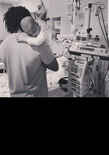 Ivy with her father James Exantus in hospital