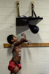 A young dancer has a quick workout  before a ceremony at the Rumbalara Football club.