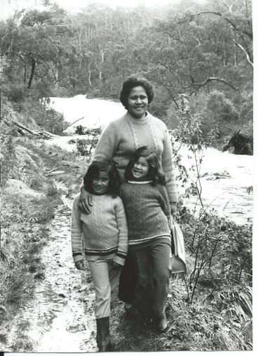 The sisters as children with mum Siniva.