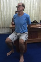 Australian filmmaker James Ricketson in police custody in Phnom Penh.