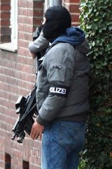 A German special police officer in Alsdorf on Tuesday.