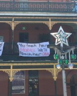 One of the banners that has been taken down from the Brass Monkey Hotel.