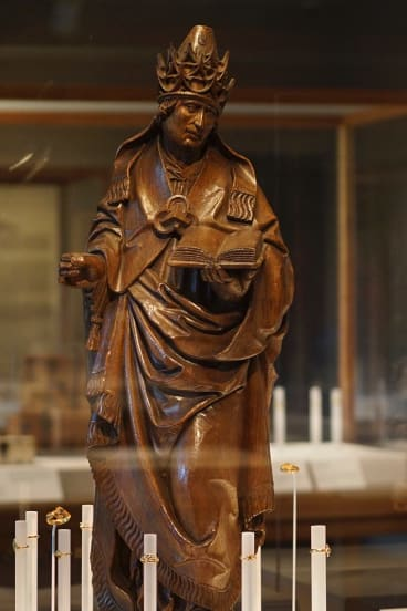 A sculpture of <i>St Gregory as Pope</i> on display at The Cloisters museum in New York City.