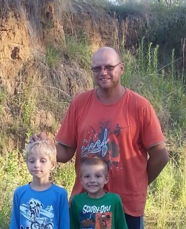 Steven Van Lonkhuyzen and his sons after being found.