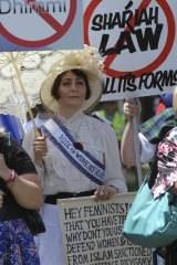 Arabella McKenzie protests dressed as a suffragete,