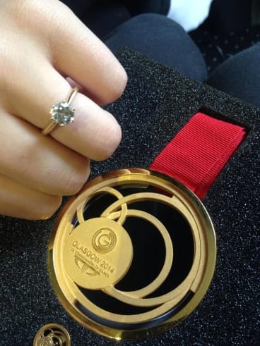 Boxer Andrew Moloney shows off his gold medal and his fiancee Chelsea-Madeleine Kean her diamond engagement ring.