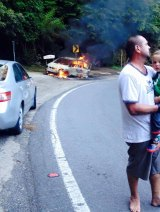 Fire engulfed Canberra mother Megan Brown's car on Pooh Bear corner.