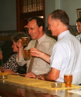 Wayne Goss and former Prime Minister Paul Keating have a beer at a Charleville pub in 1994.