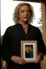 Health Minister Jill Hennessy holds a photo of her mother who has MS.