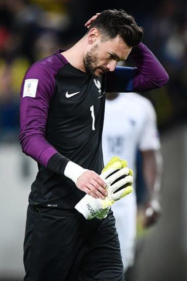 Dejected: French goalkeeper Hugo Lloris.