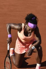 Serena Williams rests in between points at the French Open.