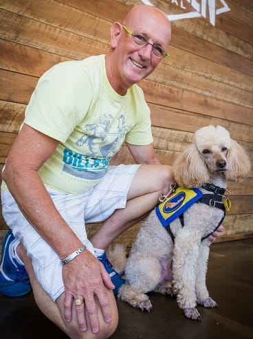 Greg Kelly, who has dementia, and his medical assistance dog Pep.