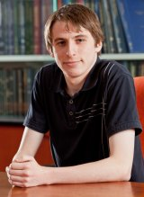 Curtis Black, who is studying properties of the Higgs boson using data from the Large Hadron Collider.