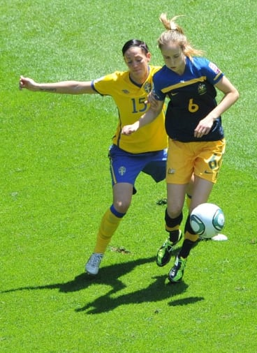 Sweden's Therese Sjogran and Ellyse Perry vie for the ball during the quarter-final soccer match of the FIFA Women's World Cup in 2011.