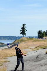 Hard work: South Korea's Byeong-Hun An  plays a bunked shot with Chambers Bay's only tree in the background.