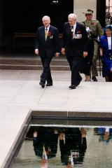 The Governor-General Sir William Deane and Chair of the Australian War Memorial Major-General  William 'Digger'  James walking to the Tomb of the Unknown Soldier at the Australian War Memorial in Canberra in 2000.