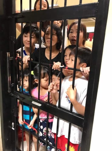 Women and children, including Tran Thi Thanh Loan (centre), in their cell at the detention centre.