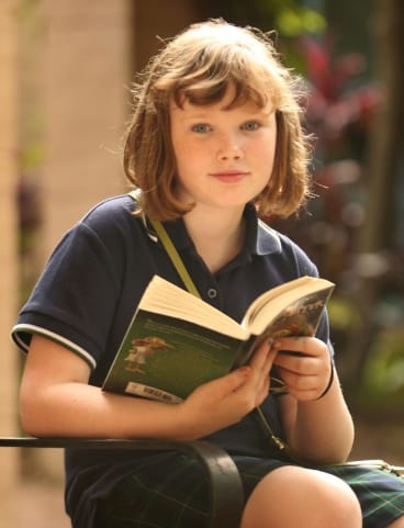 Ten-year-old Madeleine Hayen has a kindle, but still goes to Glebe Library once a week to pick up a new batch of books.
