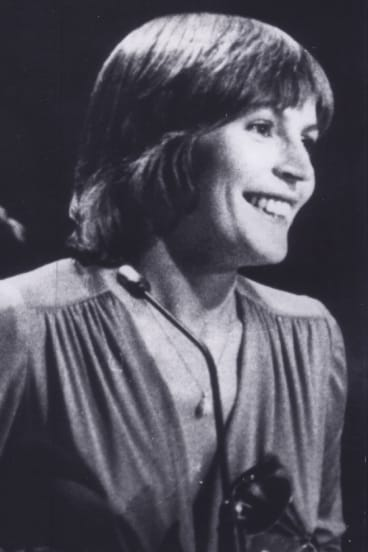 """Helen Reddy accepts her Grammy Award for the best female pop, rock and folk vocal performance in 1973. She thanked God """"because She makes everything possible""""."""