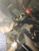 Passengers inside the derailed Amtrak train in a photo provided by former Pennsylvania Congressman Patrick Murphy, who was a passenger on the train.