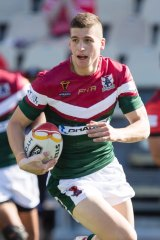Adam Doueihi scores a try in the Rugby League World Cup against Tonga.