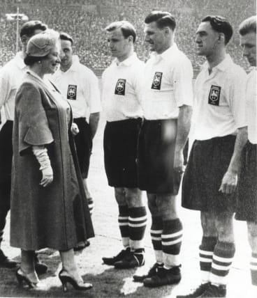 Meeting royalty: Joe Marston, the first Australian to play professionally in the UK, being presented to the Queen Mother in 1954 at Wembley.