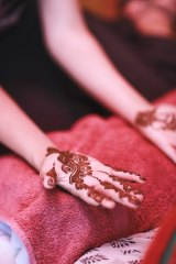Hands painted with henna.