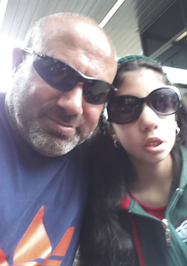 Nasser Zahr, who is fighting AAMI over a claim, with Amina, 15.