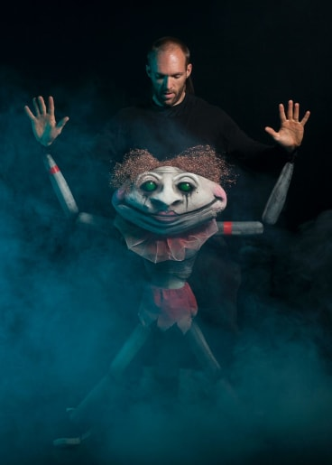 Performer Noel Holmes with one of the puppets in The Sleeping Beauty.