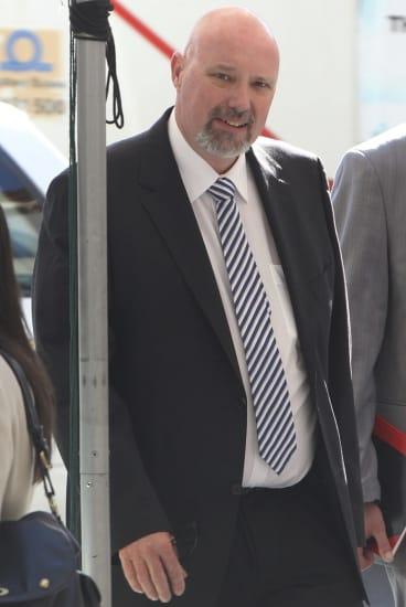 Sam Pogson enters Downing Centre District Court.