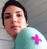 Erin Lewis-Fitzgerald wears a visibly mended cardigan.