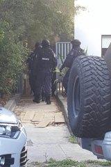Middle Eastern Organised Crime Squad officers raid Kemel Barakat's unit at Mortlake in December.