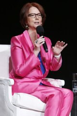 Julia Gillard speaks at a panel discussion on 'The Power of an Educated Girl' alongside Charlize Theron and Michelle Obama in 2015.