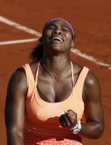 French Open: Serena Williams reacts after winning her match against Switzerland's Timea Bacsinszky.