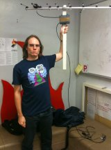 Mike Ando with the radio equipment he used to survey the Bunnings car park.