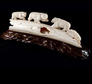 A Meiji carved ivory group of bears is in the Cammack Collection.