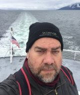 Travel writer Tim Richards in Alaska on his quest to travel the world without cash.