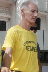 Scully in handcuffs as he arrives at Cagayan de Oro city hall on Tuesday.