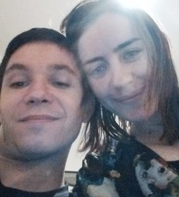 Simon Fieschi, who works at the satirical publication <i>Charlie Hebdo</i>, with Maisie Dubosarsky.